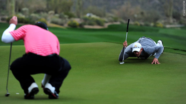 Paul Casey, right, lines up a putt during his Match Play semifinal against Carlos Villegas.