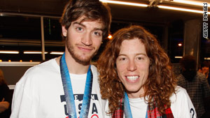 Bronze medalist Scotty Lago, left, shown here at USA House with gold medalist Shaun White, has left the Games.