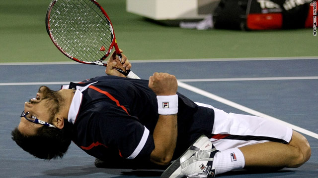 Janko Tipsarevic celebrates his superb victory over Andy Murray in the Dubai Championships.