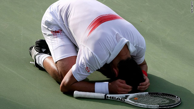 A weary Djokovic shows his relief after finally seeing off the challenge of Zouzhny in Dubai.