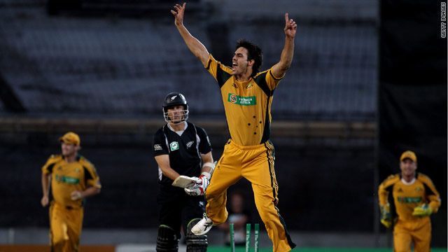 Australia's Mitchell Johnson celebrates capturing the wicket of New Zealand's Shane Bond in Auckland.