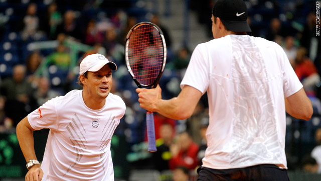 Bob Bryan and John Isner celebrate their win over Janko Tipsarevic and Nenad Zimonjic in Belgrade on Saturday.