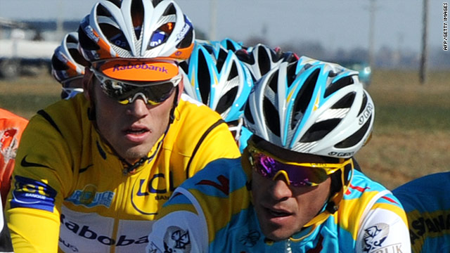 Alberto Contador (right) racing in front of overall leader Lars Boom before his crash on stage one of Paris-Nice.