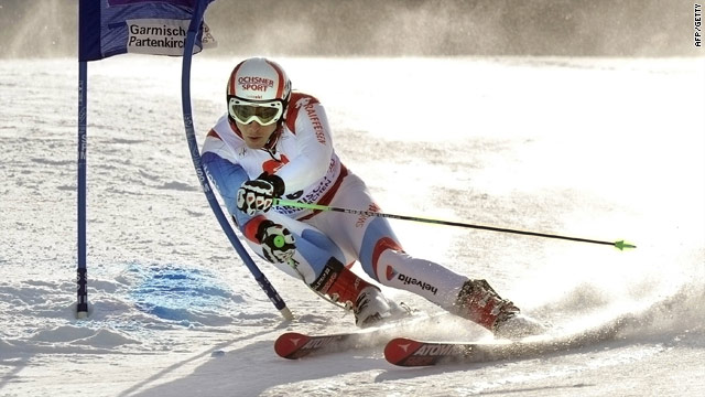 Janka shows fine style as he races to victory in the giant slalom at the World Cup finals.