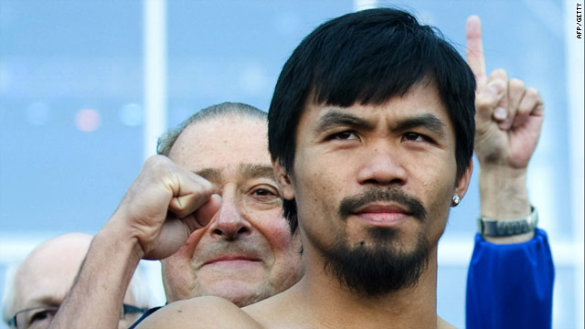 Pacquiao strikes a confident pose as he weighs-in for his fight with Clottey.