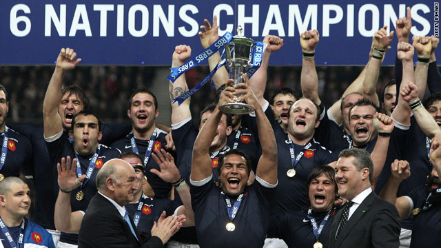 Thierry Dusautoir lifts the Six Nations trophy after France complete the Grand Slam by beating England.