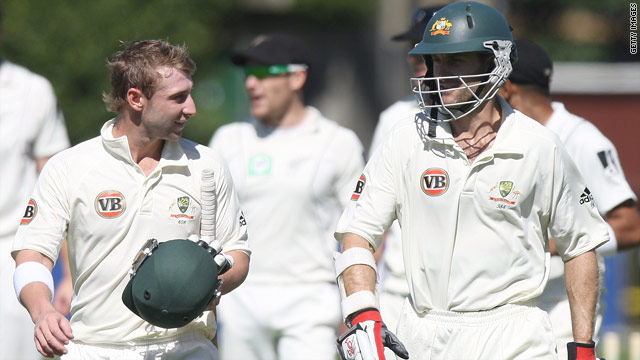 Australian batsmen Phillip Hughes (L) and Simon Katich leave the field after they secured a ten wicket win over New Zealand.