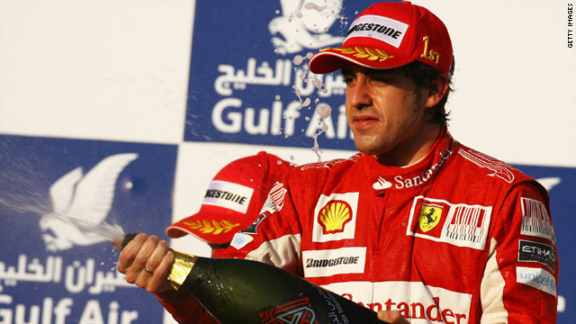 Fernando Alonso toasts his victory for Ferrari in the opening Formula One race of the season in Bahrain.