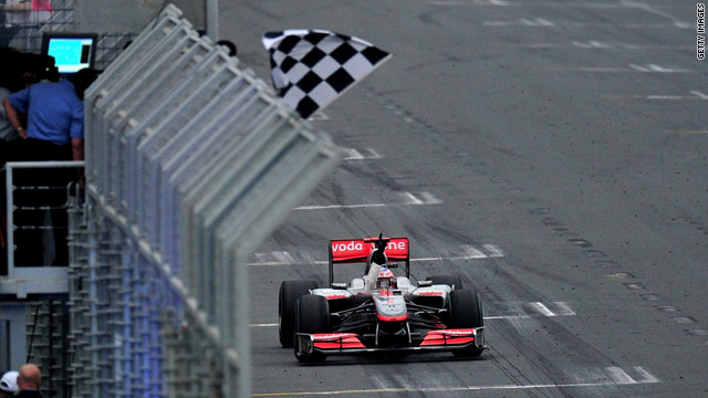 World champion Jenson Button crosses the finish line to secure victory in the Australian Grand Prix.