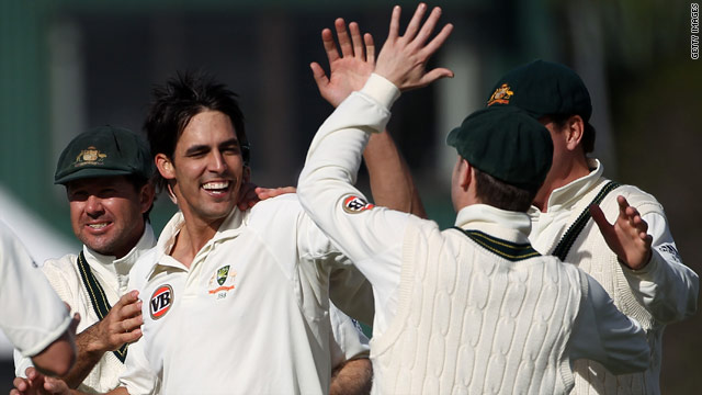 Mitchell Johnson celebrates with teammates after Australia's 2-0 series win over New Zealand