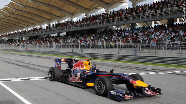 Sebastian Vettel crosses the finish line to secure a comfortable victory in the Malaysian Grand Prix at Sepang.