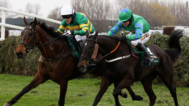 McCoy (on the left) battles it out with Denis O'Regan on Black Apalachi in the closing stages at Aintree.