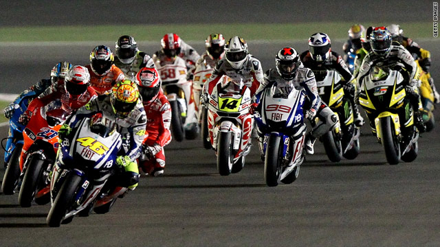 Valentino Rossi leads the field away in Qatar but this weekend's MotoGP race in Japan is off.