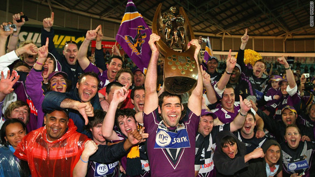 Cameron Smith lifts the NRL Premiership trophy with Melbourne Storm fans in 2009