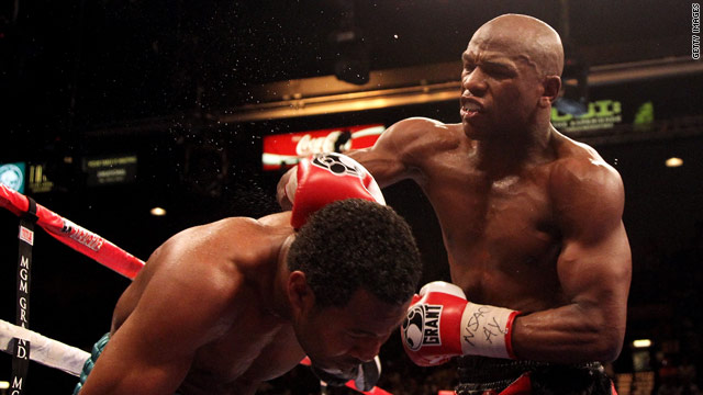 Mayweather (right) proved too strong for Mosley in Las Vegas.