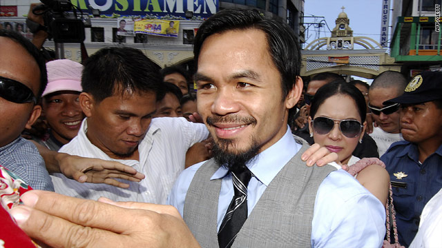 Pacquiao is mobbed by supporters as he campaigns in the Filipino elections.