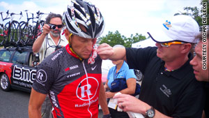Lance Armstrong is helped after he crashed Thursday at the Tour of California hours after he denied Landis' allegations.