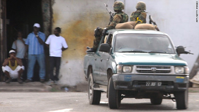 Members of the Jamaica Defense Force patrol a section of western Kingston on May 24.