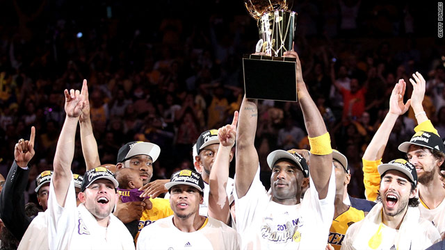 Kobe Bryant lifts the trophy as the L.A. Lakers celebrate winning their 16th NBA crown