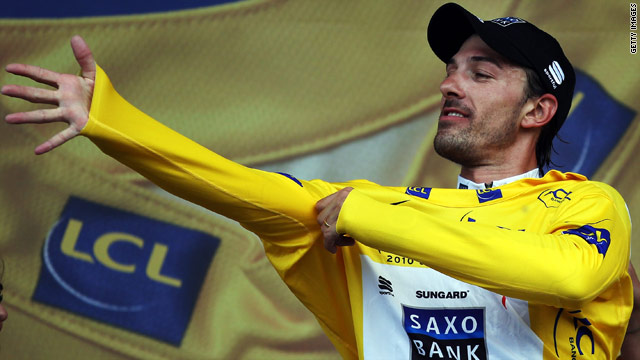 Fabian Cancellara tries on the leader's yellow jersey after winning the Tour de France prologue on Saturday.