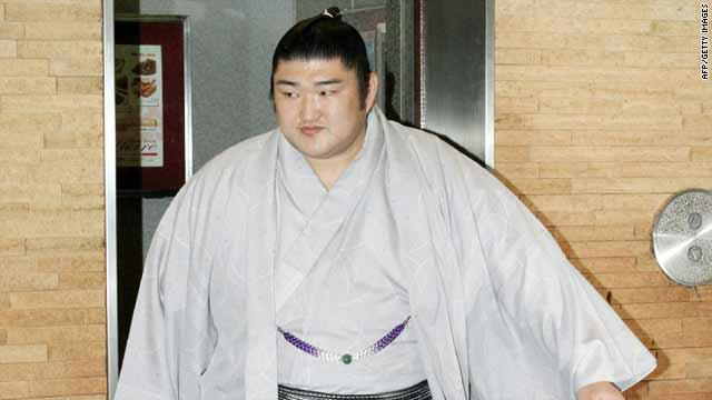 Sumo champion Kotomitsuki attends the Japan Sumo Association's executive meeting Sunday in Tokyo.