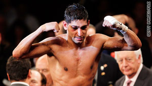 British boxing champion Amir Khan, 23, is resting at home after being briefly hospitalized, his manager says.