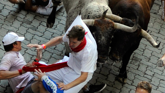 One runner is caught during the San Fermin Festival bull run, on July 07, 2010, in Pamplona, northern Spain.