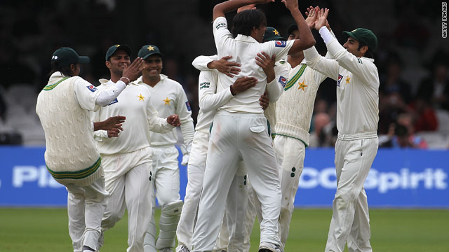Pakistan players celebrate taking the wicket of Marcus North as Australia struggled on the opening day at Lord's.
