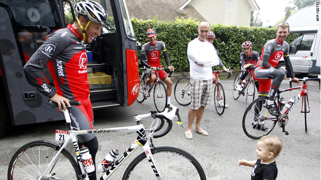 Armstrong shares a moment with his one-year-old son Max on the  Tour de France rest day in Pau.