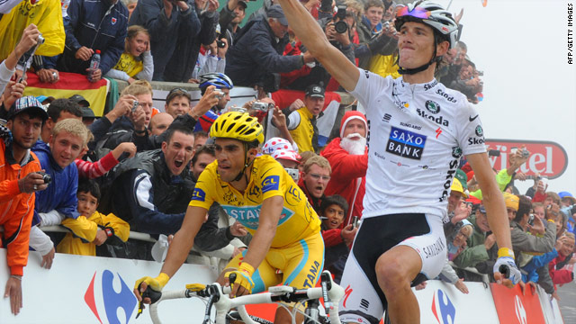 Andy Schleck finishes just ahead of Alberto Contador at the top of the Tourmalet, with the Spaniard retaining his eight-second advantage over his rival.