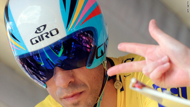 Race leader Alberto Contador gets the final countdown before setting off on Saturday's time trial stage.