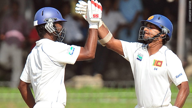 Sangakkara (right) and Paranavitana both celebrated centuries as Sri Lanka took control in Colombo.