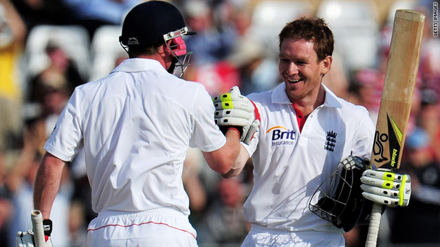 Eoin Morgan (R) is congratulated on his first Test hundred by England teammate Paul Collingwood.
