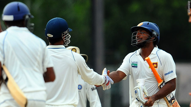 Kumar Sangakkara and Mahendra Singh Dhoni shake hands after the high-scoring draw in Colombo.
