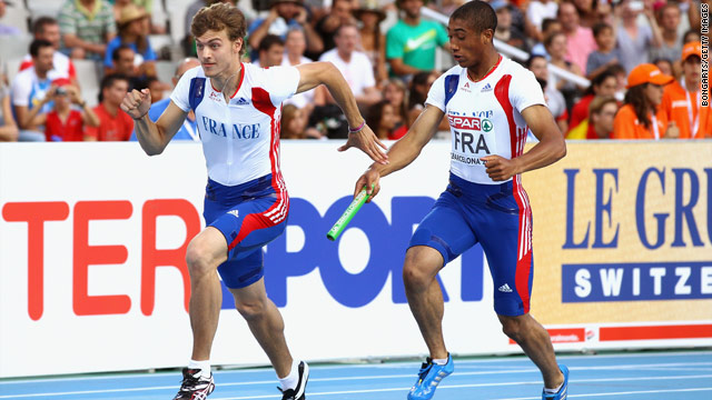 Pierre-Alexis Pessonneaux hands the baton to Christophe Lemaitre in France's 4x100m relay victory on Sunday.