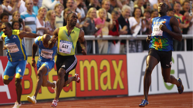 Tyson Gay looks across to his rival Usain Bolt, right, after beating the Jamaican in the 100 meters on Friday.