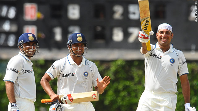V.V.S. Laxman, right, celebrates his century as Suresh Raina, center, and his runner Virender Sehwag look on.