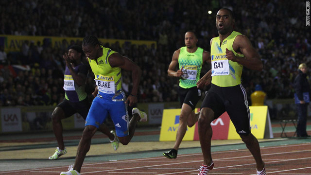 Tyson Gay (right) powers away from his rivals to clock a superb time of 9.78 seconds in the 100m in London.