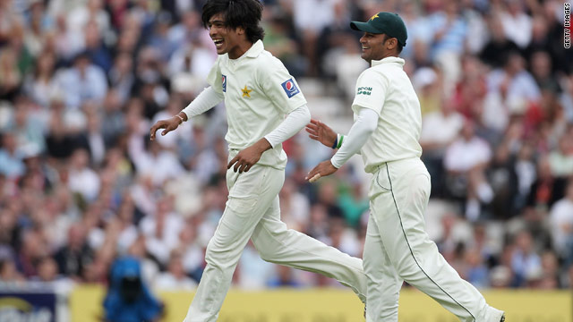 Mohammad Amir (left) celebrates taking one of his four wickets as Pakistan took control at The Oval.