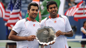 Aisam-Ul-Haq Qureshi, left, and Rohan Bopanna, right, hold the 2nd place trophy at the U.S. Open.
