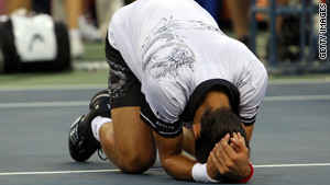Novak Djokovic celebrates defeating Roger Federer in their men's singles semifinal match Saturday.