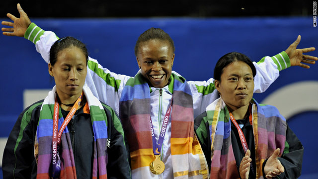Nigerian weightlifter Augustina Nkem Nwaokolo (C) celebrates after winning the first gold of the Commonwealth Games.