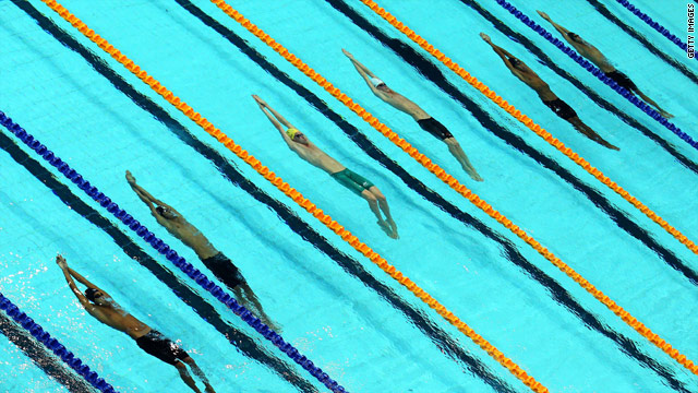 Competitors in a heat of the Men's backstroke 50m on Monday.