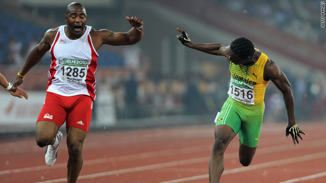 Lerone Clarke (right) beats Mark Lewis-Francis to the Commonwealth Games 100m gold.