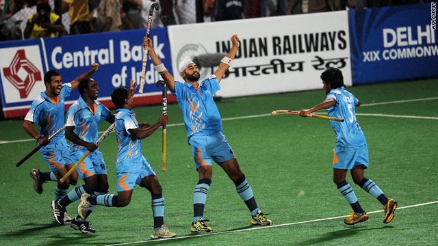 Sandeep Singh celebrates a goal as India thrash Pakistan in the field hockey preliminaries at the Commonwealth Games.