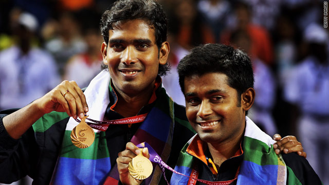 Achanta Sharath Kamal (L) and Subhajit Saha pose with their gold medals after winning the men's doubles table tennis final.