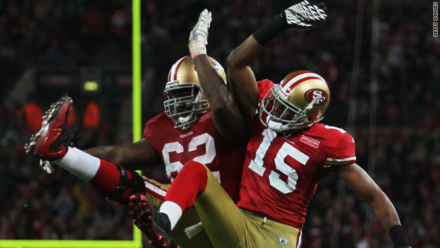 Michael Crabtree (No.15) celebrates his touchdown with 49ers teammate Chilo Rachal.