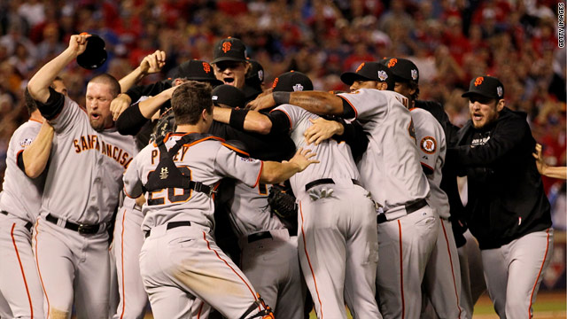 San Francisco Giants players celebrate after winning the team's first World Series title since 1954.