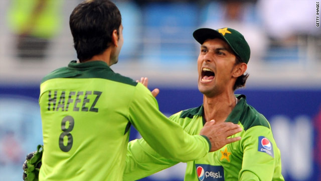 Pakistan wicketkeeper Zulqarnain Haider (R) celebrates with teammate Muhammad Hafeez in a recent ODI against South Africa.