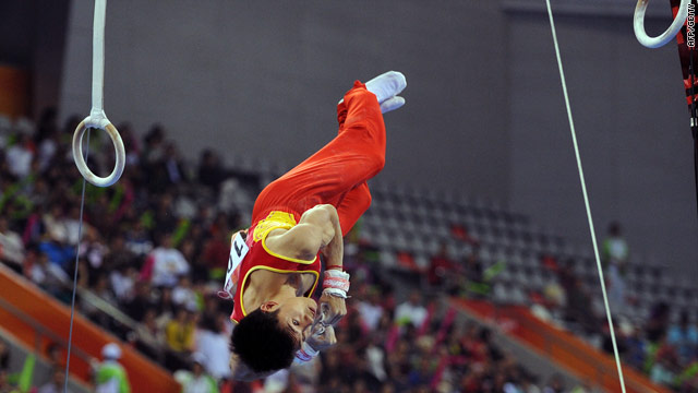 Haibin Teng of China performs on the rings as they win the men's gymnastics team gold.